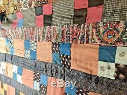 Antique Handmade Quilt with very vintage farbic and all hand knotted