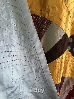 Very large vintage folk art, hand made necktie fan quilt. Excellent condition. Wow