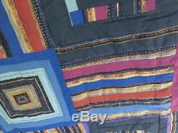 Vintage/Antique Handmade Quilt with a dark background great quilt for any room